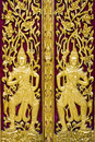 Gold thai carve style on door in temple buddhism Royalty Free Stock Images