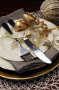 Gold theme Christmas dinner table setting. Close up on cutlery and plates Royalty Free Stock Photo
