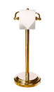 Gold toilet paper holder standing isolated on white Royalty Free Stock Photo