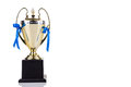 Gold trophy with blue decorative ribbons on white background Royalty Free Stock Photo