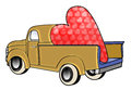 Gold truck with huge valentine Stock Images