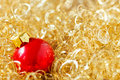 Gold twinkle christmas background golden with red bauble Royalty Free Stock Image