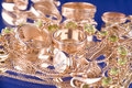 Gold valuable on blue Royalty Free Stock Photo