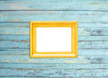 Gold Vintage picture frame on blue wood background Stock Photos