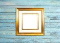 Gold Vintage picture frame on blue wood background Royalty Free Stock Photo