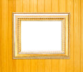 Gold Vintage picture frame on wood background Stock Images