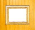 Gold Vintage picture frame on wood background Stock Images