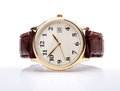 Gold watch leather strap with brown and white face Royalty Free Stock Image