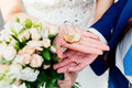 Gold wedding lock in the form of heart in the hands Royalty Free Stock Photo