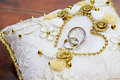Gold wedding ring on pillow Royalty Free Stock Image