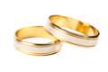 Gold wedding rings over white Stock Photos
