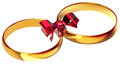 Gold wedding rings with the silk bow Royalty Free Stock Photo