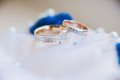 Gold wedding rings on white Royalty Free Stock Photography