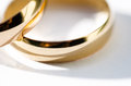 Gold wedding rings on white background Stock Image