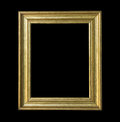 Gold wooden frame isolated on black background old Royalty Free Stock Image