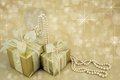 Gold wrapped presents with pearls Royalty Free Stock Images