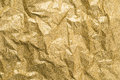 Gold wrinkled paper texture abstract background Royalty Free Stock Photo