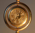 Gold yin yang sign surrounded by trigrams close up Stock Photo