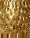 Golden abstract background in the form of a spray of scales and spots.