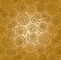 Golden abstract spiral pattern. Seamless decorative background Royalty Free Stock Photo
