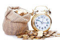Golden alarm clock great faces on coins time is money Royalty Free Stock Photo