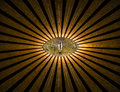 Golden all-seeing anonymous eye with lines and lights abstract religion background.