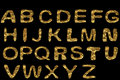 Golden alphabet set gold letters unusual textured Stock Photos