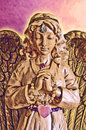Golden angel statue in prayer with eyes closed praying she has a rose quartz heart amethyst and jewels on her third eye and throat Stock Images