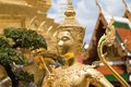 The golden angel statue in temple of emerald buddha historic centre of bangkok within precincts of grand Stock Photos