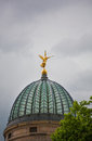 Golden angel statue with trumpet on the top Royalty Free Stock Photo