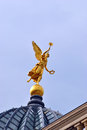 Golden angel on the top of the dome sculpture an gold building academy in dresden germany Royalty Free Stock Photos