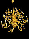 Golden antique chandelier isolated in black Royalty Free Stock Images