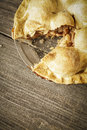 Golden Apple Pie on Rustic Barnwood With One Slice Gone Royalty Free Stock Photo