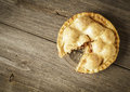 Golden Apple Pie on Rustic Barnwood With One Slice Gone Stock Images