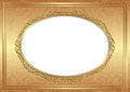 Golden background with decorative oval frame and transparent space insert for picture or text Royalty Free Stock Image