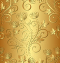 Golden background with floral ornaments Stock Photography