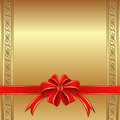 Golden background with a red bow for gifts Royalty Free Stock Photo