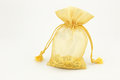 Golden bag sparse and gold ornament on white background Stock Image