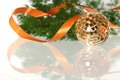 Golden ball with orange ribbon and firtree Stock Photo