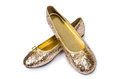 Golden ballet shoes isolated on white Royalty Free Stock Photo