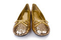 Golden ballet shoes isolated on white Royalty Free Stock Image