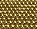 Golden balls pattern reflective texture gold metallic ball bearing tightly packed with textures beads array Royalty Free Stock Images