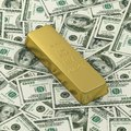 Golden bar or ingot on dollar banknote background Stock Photography