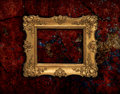 Golden baroque frame on a red grunge texture precious vintage background Stock Photo