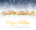 Golden baubles on snow with silver sparkle background Royalty Free Stock Images