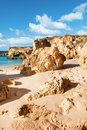 Golden beaches of albufeira portugal and sandstone cliffs near Stock Image