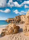 Golden beaches of albufeira and sandstone cliffs near portugal Stock Images