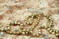 Golden bead necklace Stock Photos