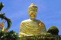 Golden big buddha statue nice with blue sky at country of thailand Stock Photos
