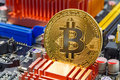 Golden bitcoin on the computer motherboard background closeup. Cryptocurrency virtual money Royalty Free Stock Photo